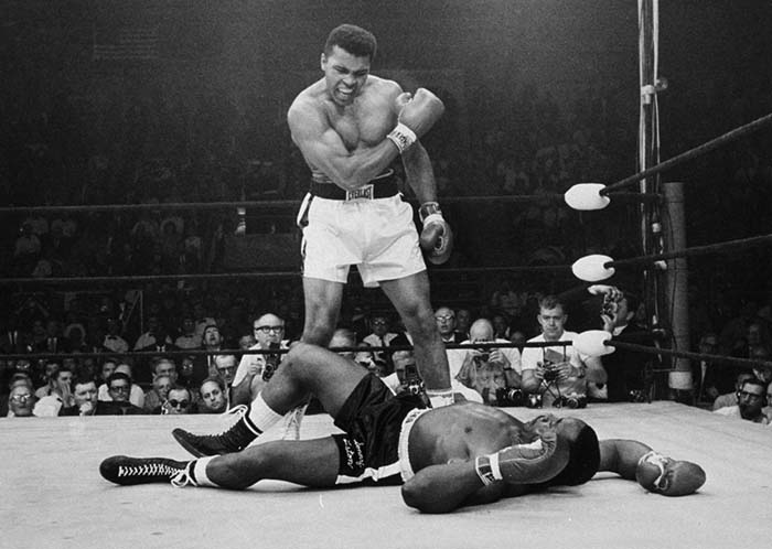 Heavyweight champion Muhammad Ali stands over fallen challenger Sonny Liston, shouting and gesturing shortly after dropping Liston with a short hard right to the jaw on May 25, 1965, in Lewiston, Maine.